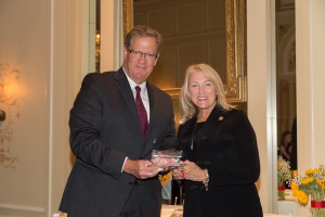 Senator Jeanie Riddle receives the 2018 Crystal Wagon Award from Raymond Wagner, member of SSM Health Cardinal Glennon Children's Foundation Board of Governors.